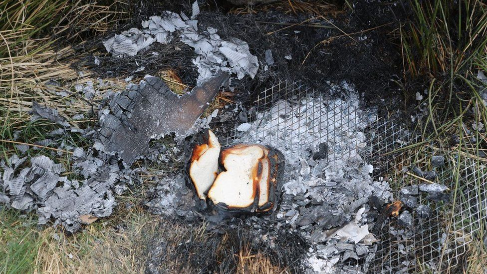 Bread on burnt out barbecue