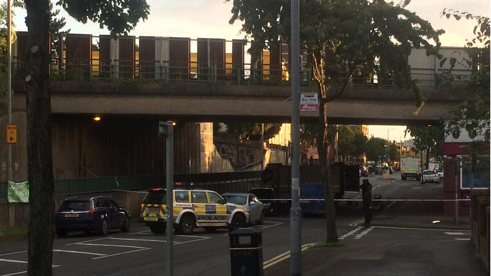 Police and Army bomb disposal officers at the scene of the security alert