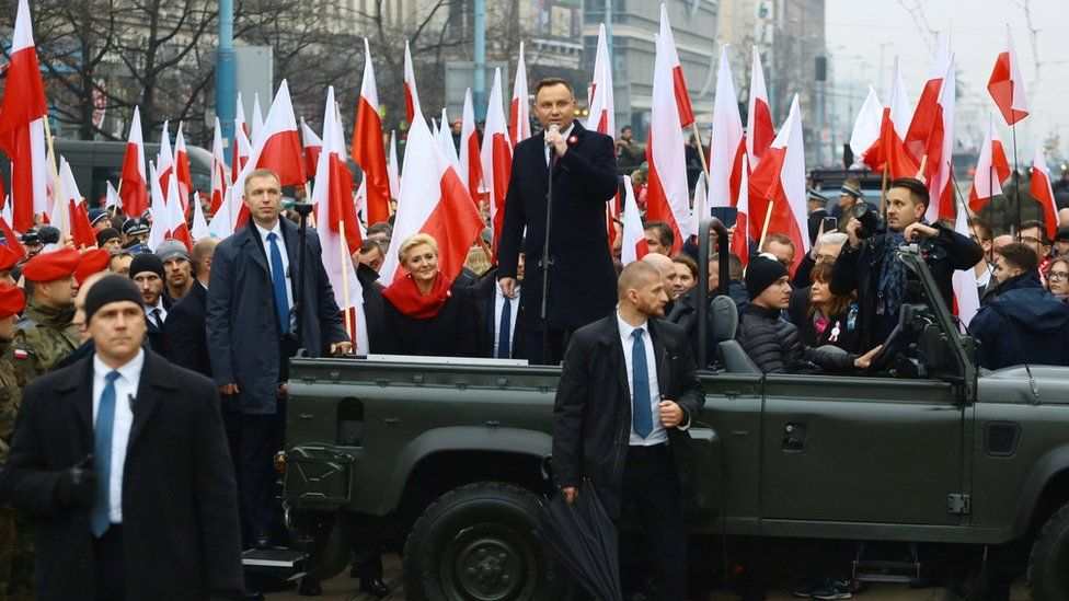 Poland's President Andrzej Duda delivers a speech before the official start of a march marking the 100th anniversary of Polish independence in Warsaw, 11 November 2018