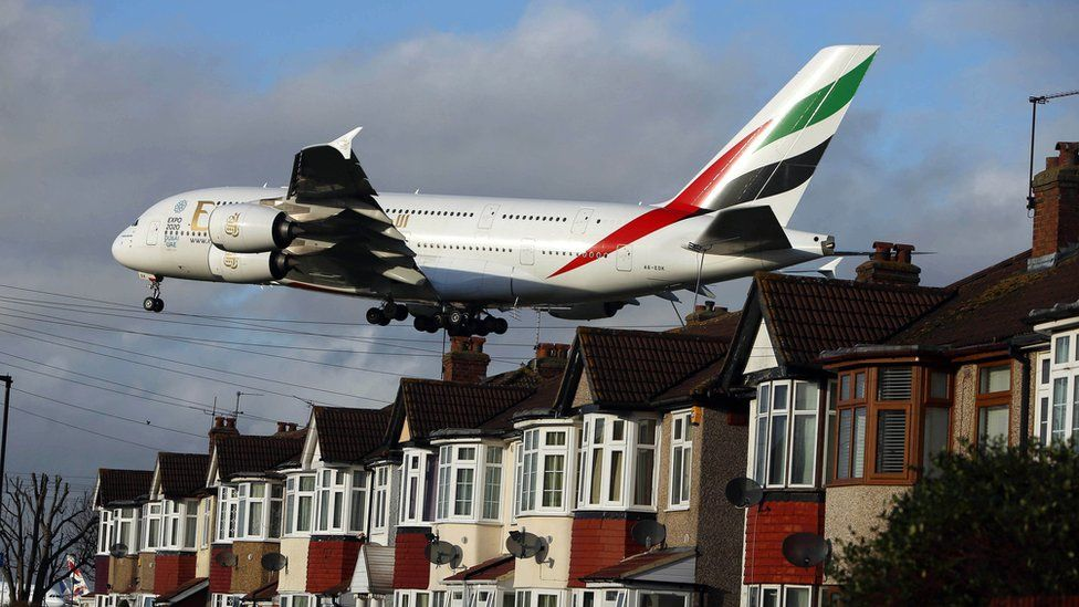 Plane landing over houses near Heathrow Airport