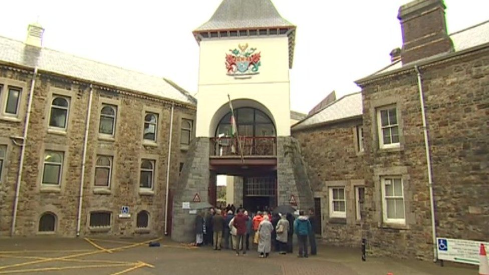 Protestors gathered outside Gwynedd council's chamber on Friday
