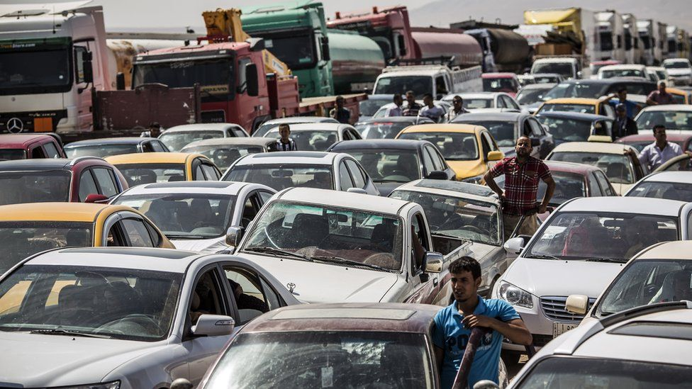 Traffic from Mosul queues at a Kurdish Check point in 2014 after Mosul was taken by IS
