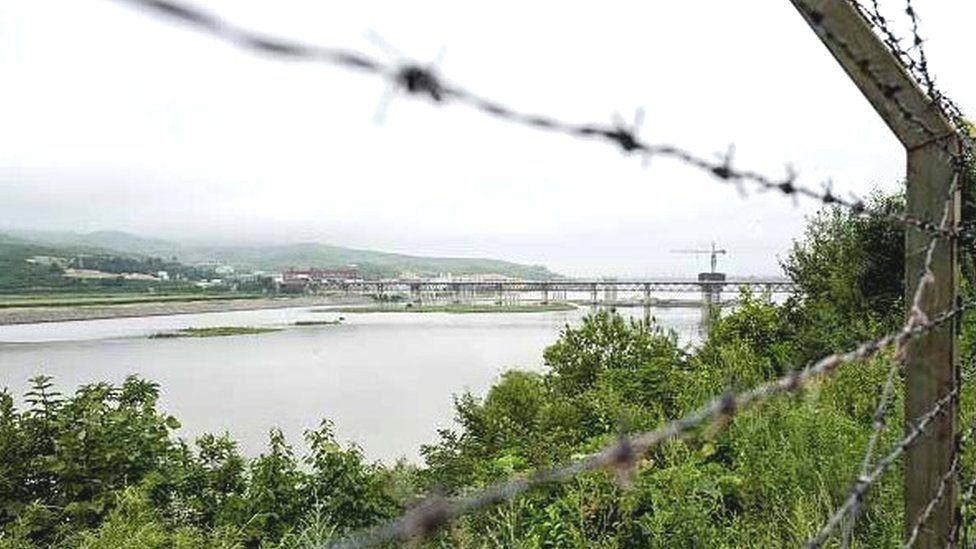 Fences run along the Tumen river