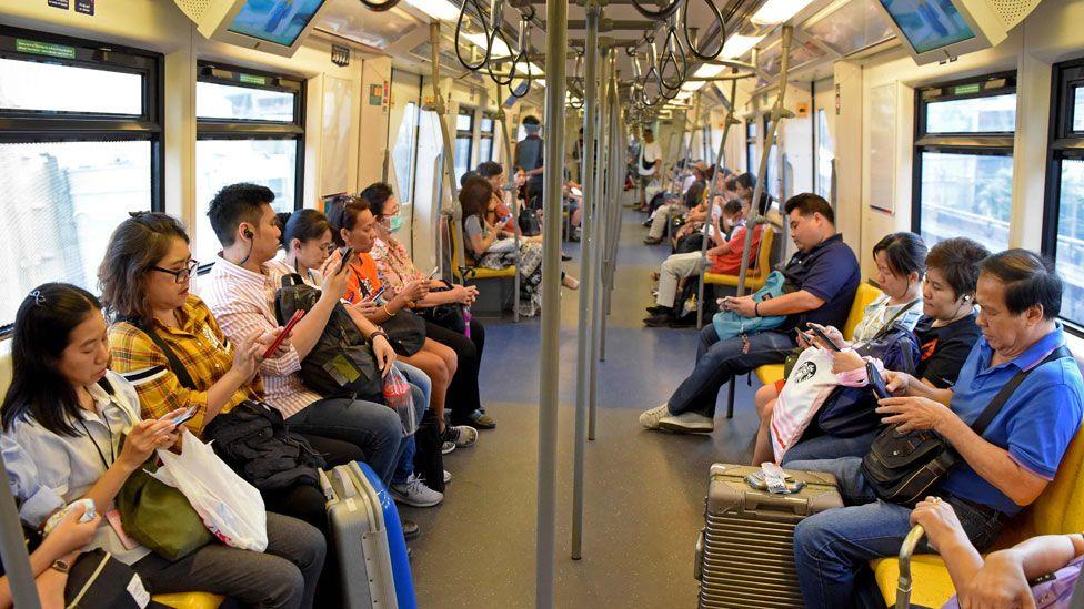 People on a train in Bangkok