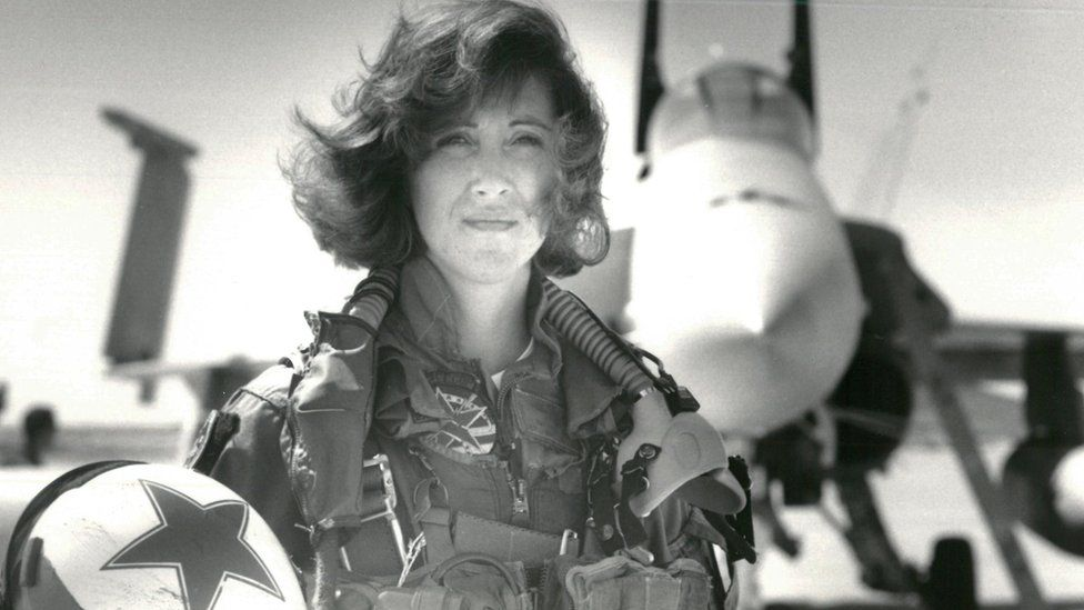 U.S. Navy Lieutenant Tammie Jo Shults, who is currently a Southwest Airlines pilot, poses in front of a Navy F/A-18A in this 1992 photo released in Washington, DC, U.S., April 18, 2018.