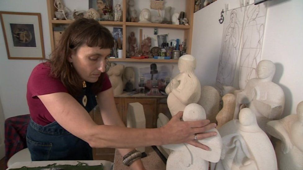 Lucy Churchill with her sculptures