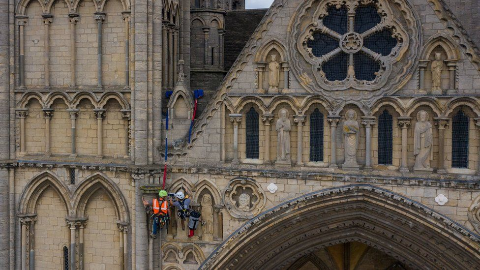 Conservationists abseil Peterborough Cathedral