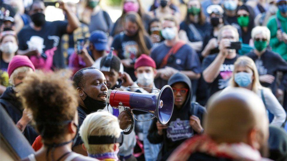 Mark Henry Jr. of Black Lives Matter addresses a crowd in the Chaz