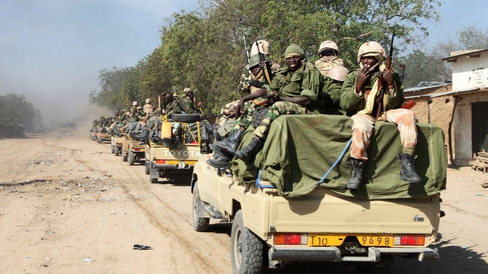 Chadian soldiers patrol in the Nigerian border town of Gamburo
