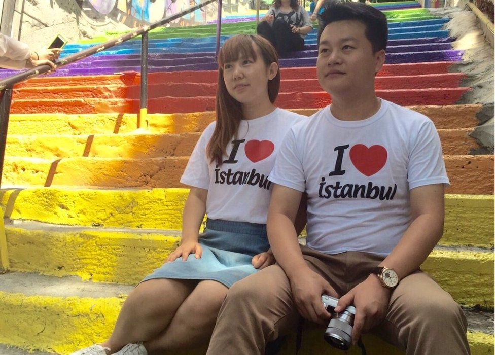 A Chinese couple wears 'I love Istanbul' t-shirts