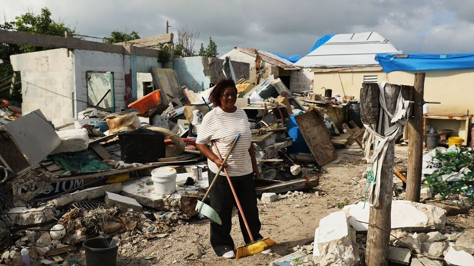 Flo Webber stands amongst the debris of her home on the nearly destroyed island of Barbuda which was nearly levelled when Hurricane Irma made landfall with 185mph winds.