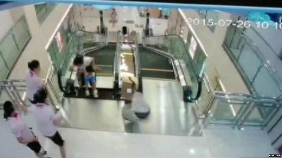 Surveillance video showing the woman and child on the escalator, provided by CCTV to Reuters, 26 July 2015