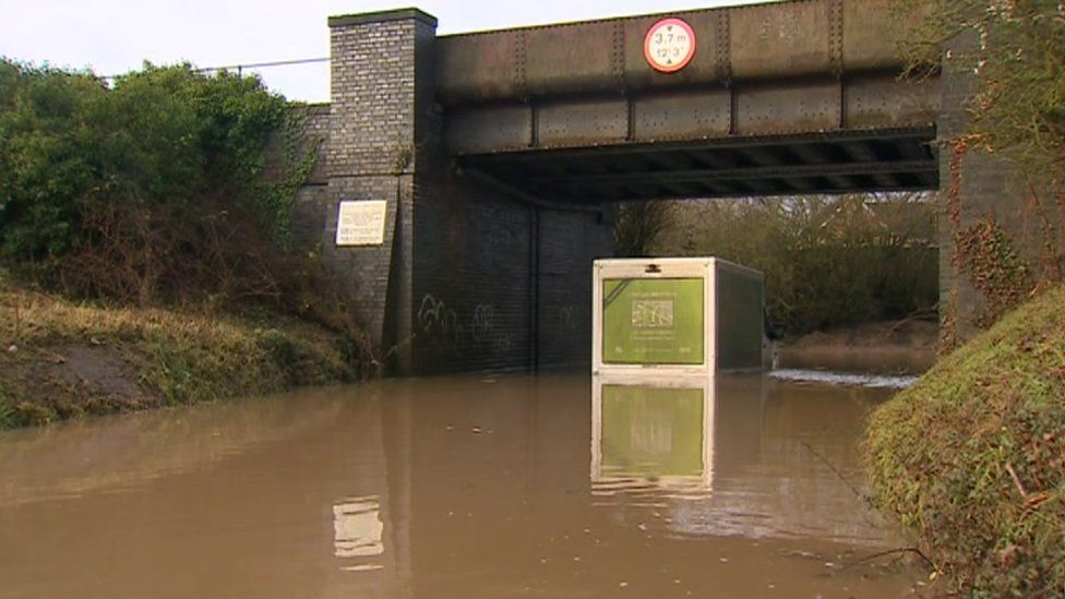 Asda truck in flood hit road