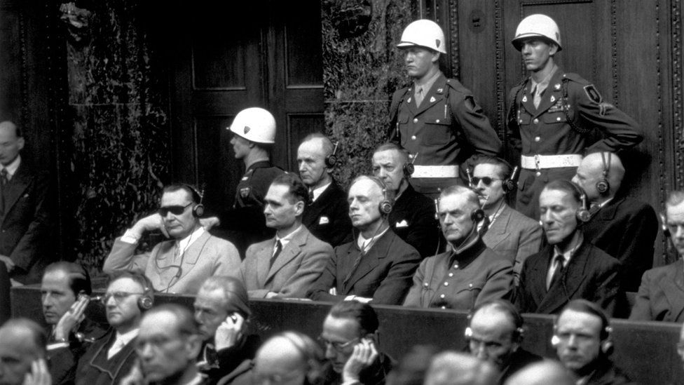 Some of the chief defendants listening to the court summary at the Nuremberg War Trials. In the front row (from left to right) are Goering, Hess, von Ribbentrop, Keitel, Kaltenbrunner and Rosenberg. In the back row are Doenitz, Raeder, von Schirach and Sauckel