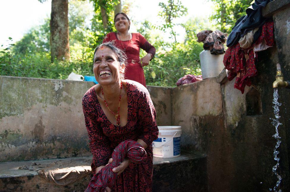 Women washing clothes near Sabin's home