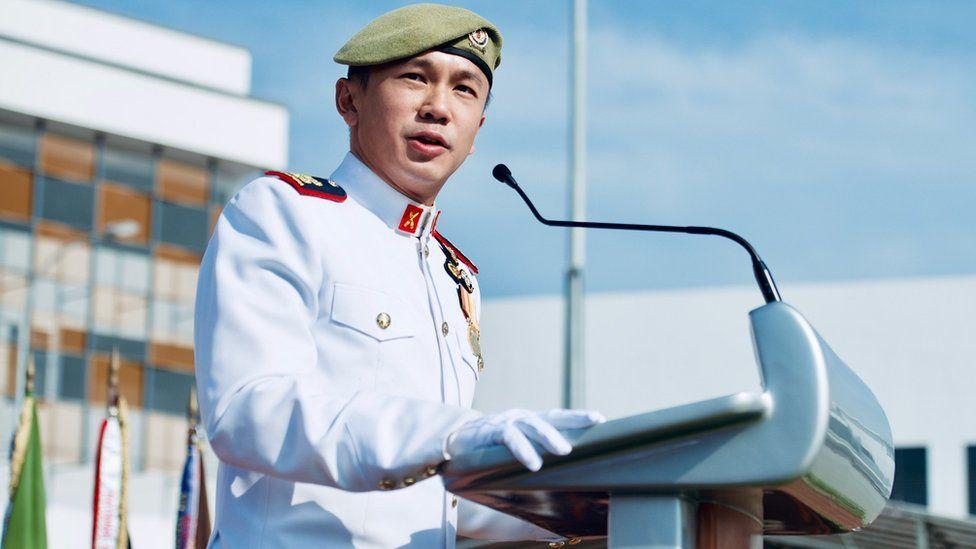 Lt Col JC Choy in uniform giving a speech