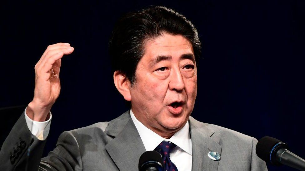 Japanese Prime Minister Shinzo Abe gives a press conference at the end of a G7 summit of Heads of State and of Government, on 27 May 2017 in Taormina, Sicily