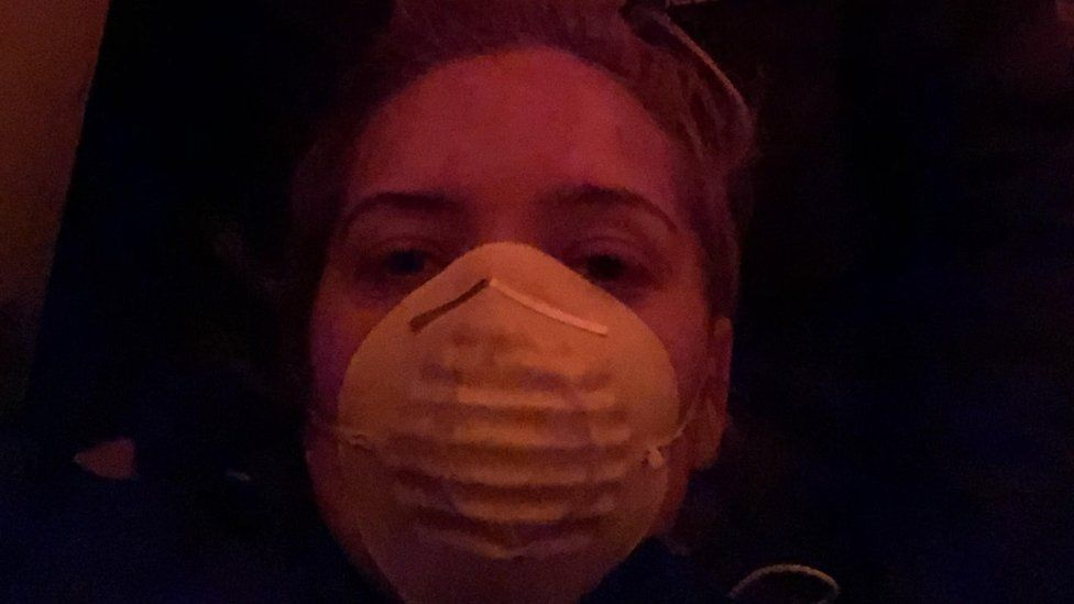 Amy Savage wearing a face mask on the boat out on the water at Mallacoota