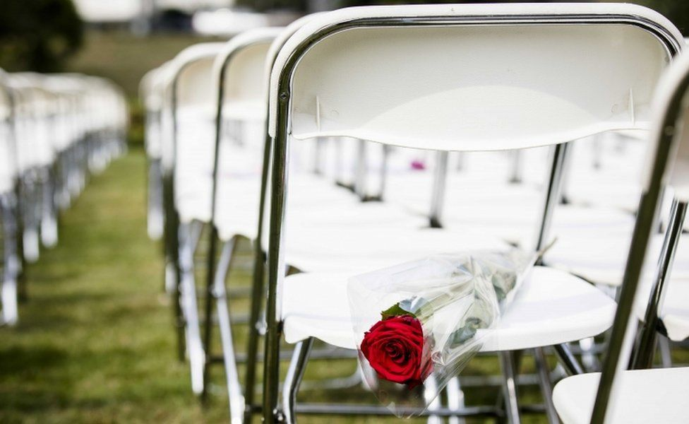 White chairs and red roses are set up by relatives of crash victims of flight MH17 as a silent protest in front of the Russian embassy in The Hague, The Netherlands, 8 May 2018