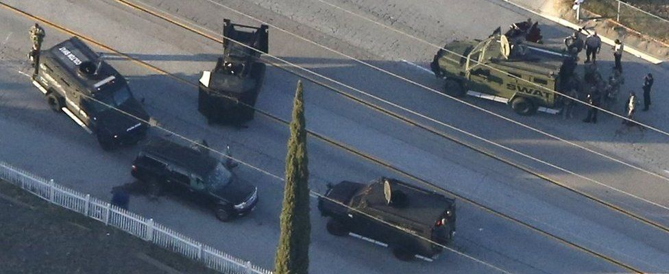 An SUV with its windows shot out that police suspect was the getaway vehicle from the scene of a shooting in San Bernardino, California is shown in this aerial photo December 2, 2015.