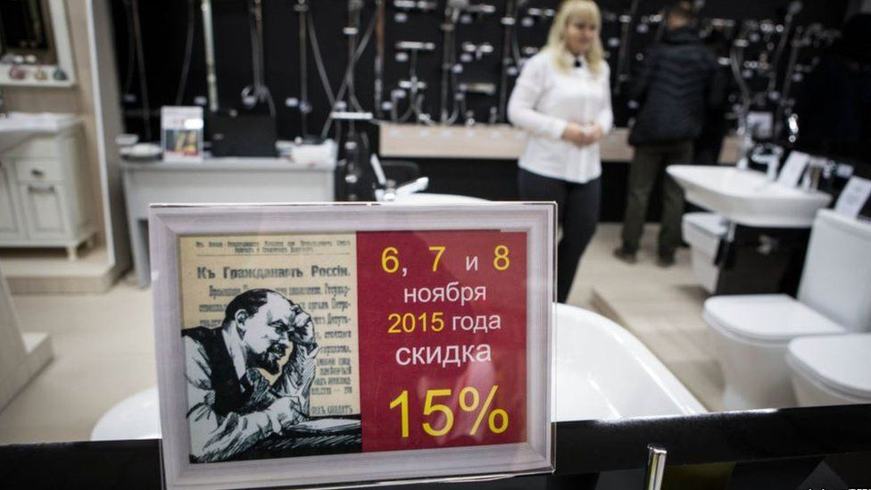 A sale sign featuring Lenin's portrait in a bathroom showroom