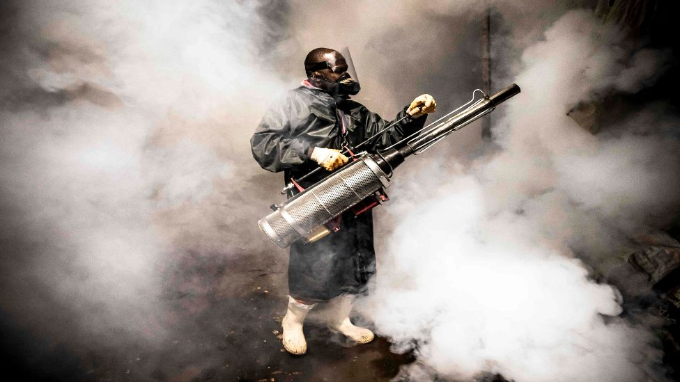A member of a privately-funded NGO fumigates in Kenya