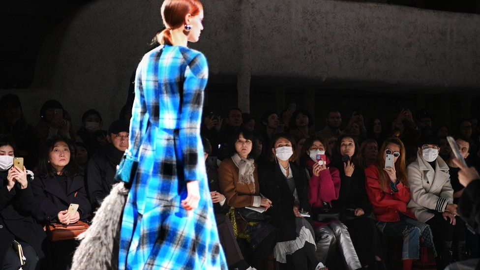 Guests at Dries Van Noten's Paris show wearing facemasks