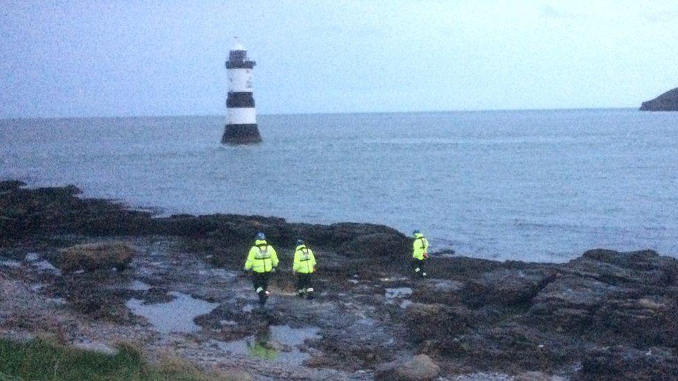 Coastguard volunteers begin searching the coast at Penmon