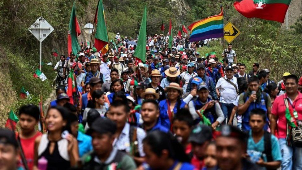 Members of the indigenous Nasa group marching the municipality of Toribio, Cauca department, on their way to attend the National Meeting of Indigenous Guards on 11 October 11, 2019.