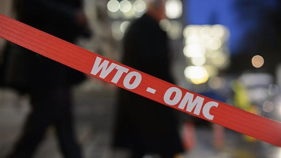 Barrier with the WTO-OMC sign on it