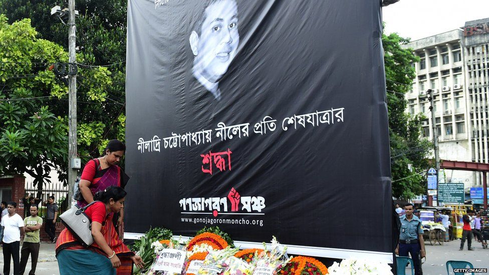 Bangladeshi women in Dhaka place a floral wreath during a protest against the killing of blogger Niloy Neel on 9 August