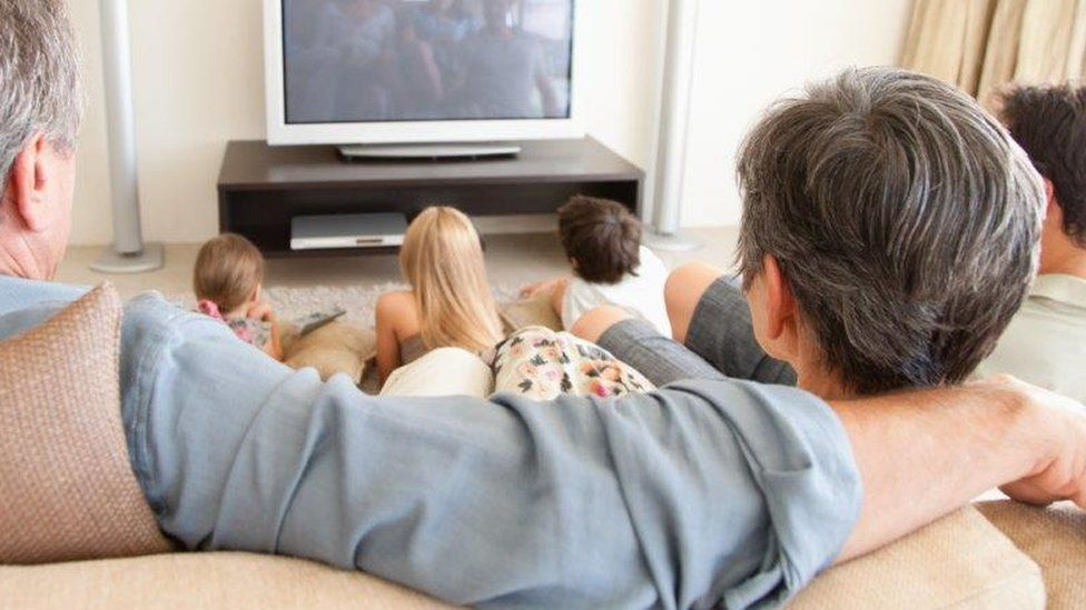 Large family watch tv