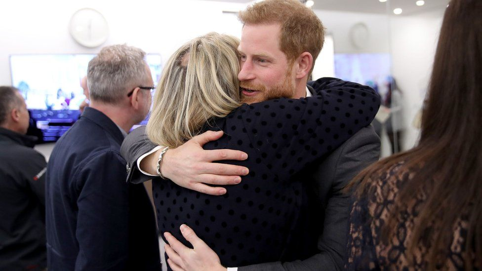 Prince Harry hugs journalist Bryony Gordon during the first Royal Foundation Forum in central London in 2018
