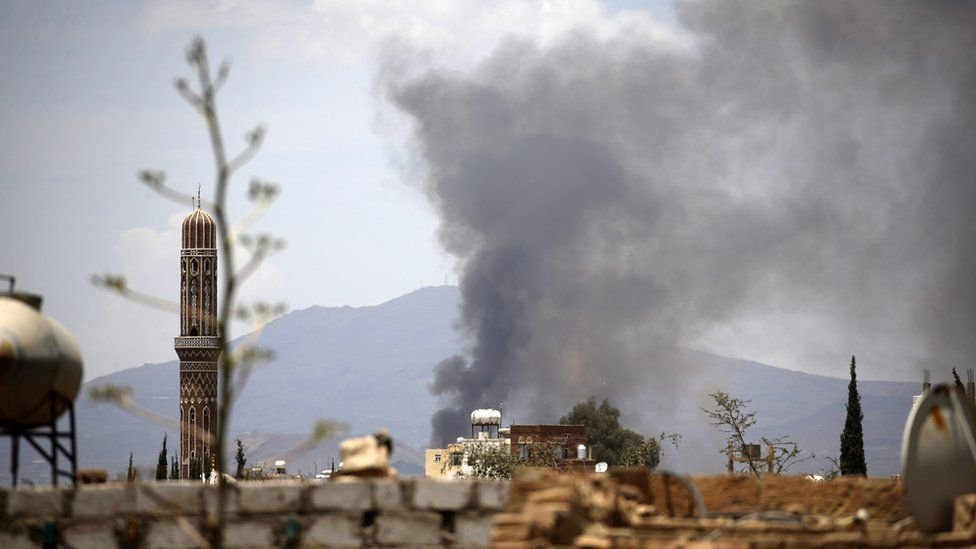 Smoke billows following an air-strike by the Saudi-led coalition targeting the Al-Dailami air base, in the capital Sanaa on April 5, 2018