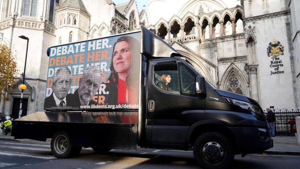 A Liberal Democrat advertising van drives past the High Court in London
