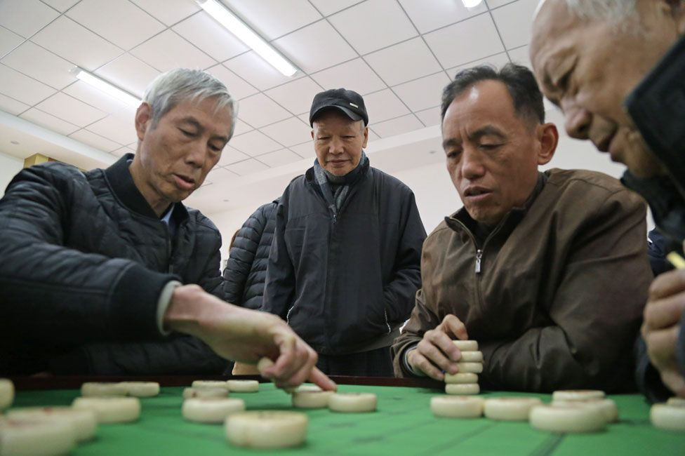 Playing a board game at Fujian centre for old people