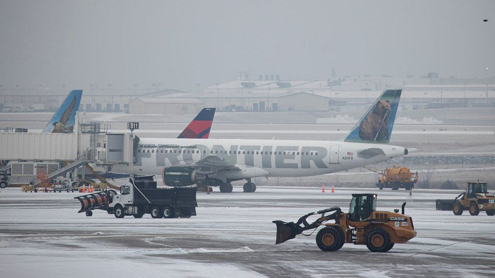 Snow removal vehicles clear ice from around planes at Nashville International Airport on February 15, 2021 in Nashville, Tennessee