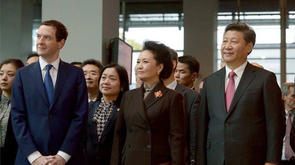George Osborne, left, stands with China's President Xi Jinping, right, his wife Peng Liyuan, centre