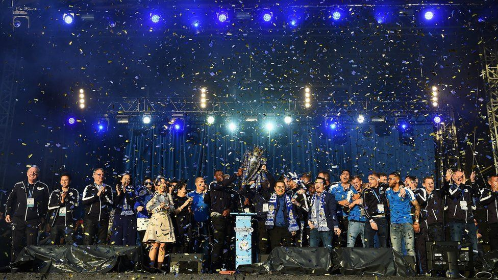 Leicester City show the trophy to the fans during the celebrations at Victoria Park