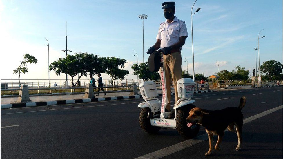 A traffic police officer rides a self-balancing scooter in Chennai