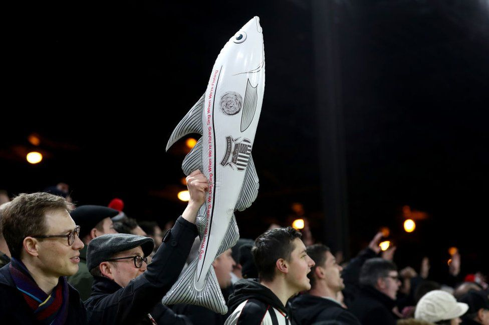 Grimsby Town supporters brandishing an inflatable fish