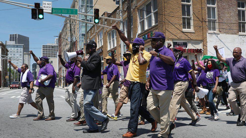 Image shows Crump leading a march in Atlanta, Georgia