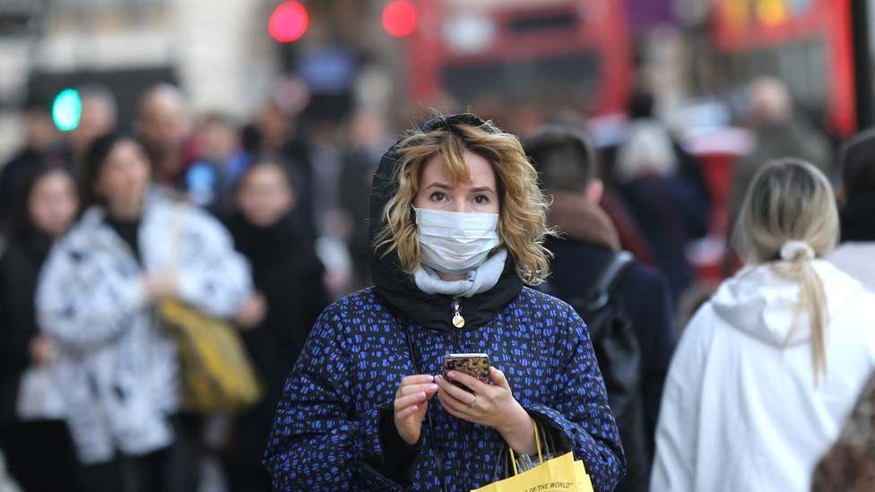 A woman wearing mask