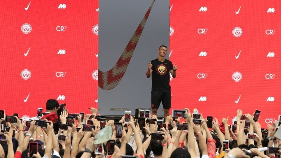 Cristiano Ronaldo gestures as fans take photos of him, during an event held by Nike. File photo