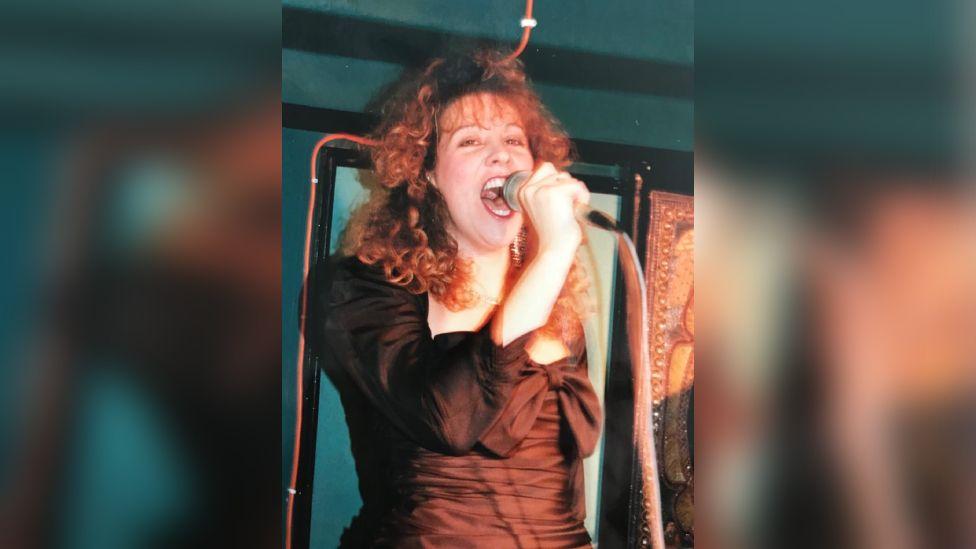 Jill singing karaoke in the 1980s