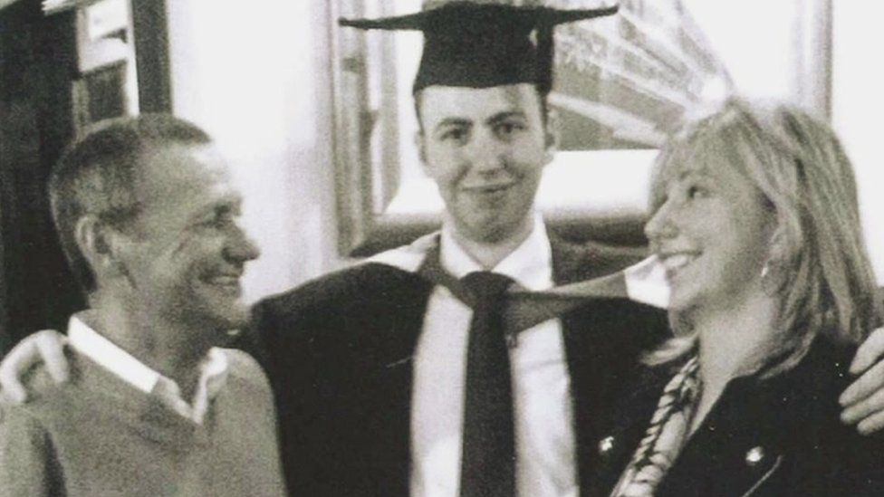 Mr Murphy with son and lady at graduation