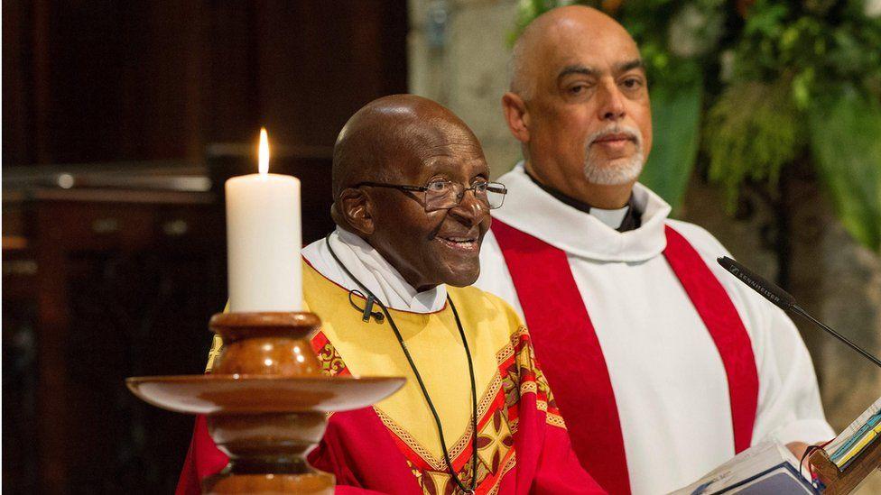 Former archbishop Desmond Tutu celebrates a mass with Dean Michael Weeder to mark his 85th birthday