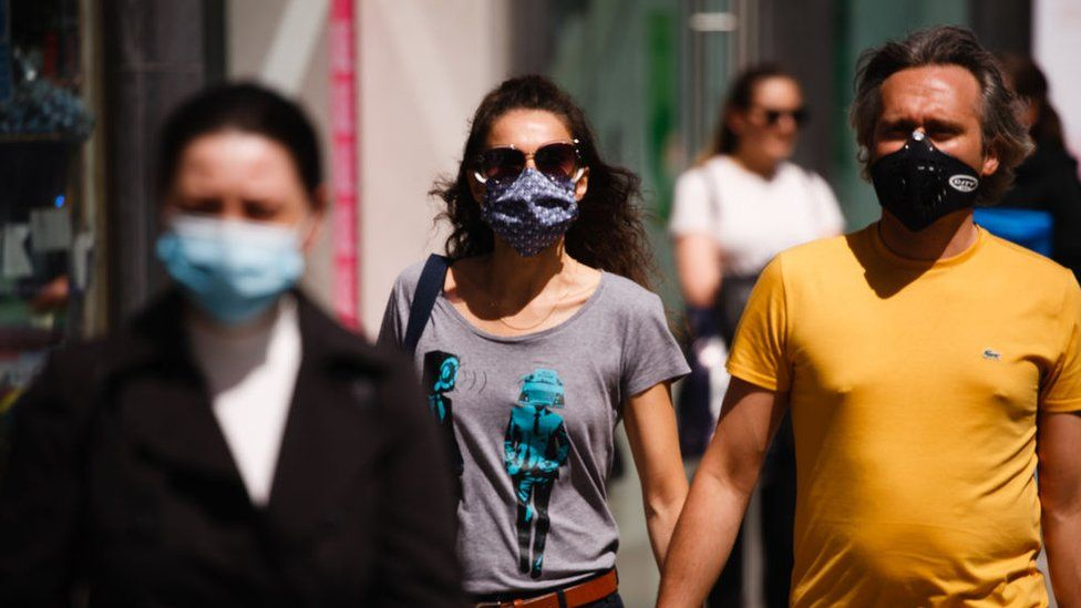 People wearing masks on the street