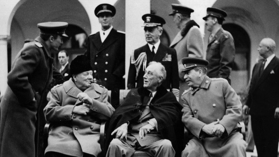 British Prime minister Winston Churchill (L), US president Franklin Delano Roosevelt (C) and USSR Secretary general of the Soviet Communist Party (PCUS), Joseph Stalin (R) pose at the start of the Conference of the Allied powers in Yalta, Crimea, on February 4, 1945 at the end of World War II.