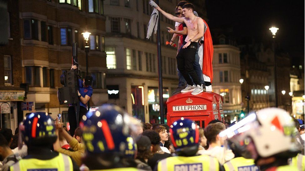 Fans gather for England v Denmark - Piccadilly Circus, London, Britain